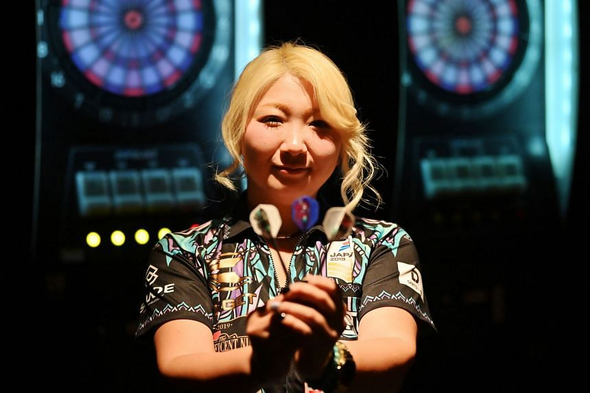 Described as the Phil Taylor of women's darts, Japan's Mikuru Suzuki has plans to dominate the sport after becoming the first Asian player to capture a world title. PHOTO: AGENCE FRANCE-PRESSE