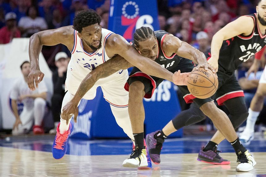 Philadelphia 76ers centre Joel Embiid (far left) guarding Toronto Raptors forward Kawhi Leonard during their National Basketball Association play-off semi-final on Thursday. The duo had 33 points each but hosts Sixers won 116-95 for a 2-1 series lead