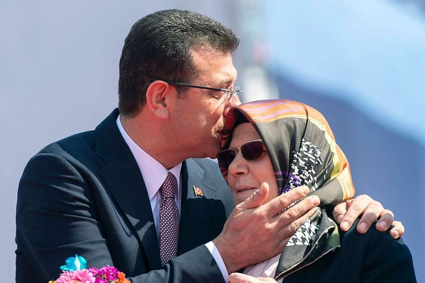Mayor of Istanbul Ekrem Imamoglu kisses his mother Hava Imamoglu during a rally in Istanbul.