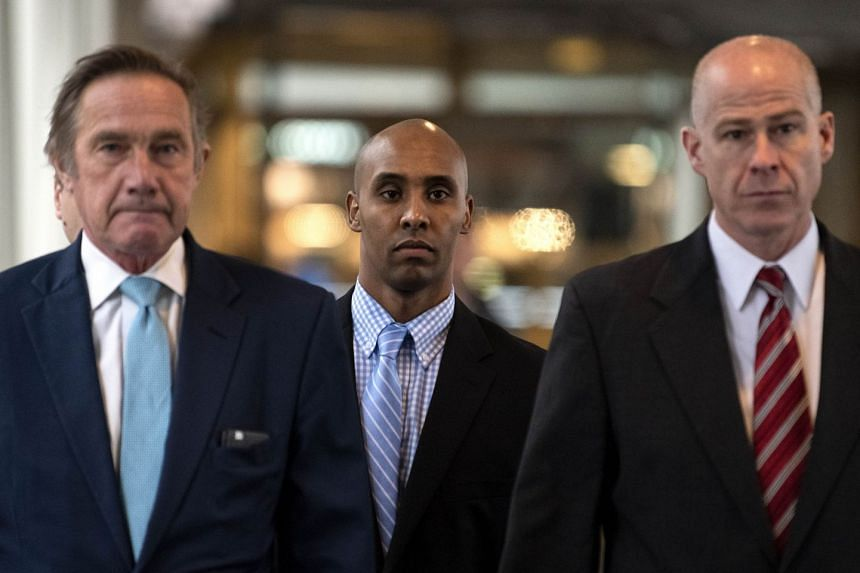 Mohamed Noor and his legal team arrive at the Hennepin County Government Centre n Minneapolis, after the jury reached a verdict.
