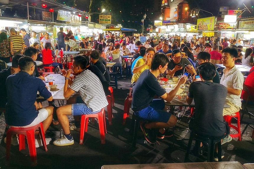 Hawker stalls at Penang's Gurney Drive waterfront. Penang state government's idea of Singapore and Malaysia filing a joint-nomination to list hawker culture under Unesco did not go down well with critics on both sides of the Causeway.
