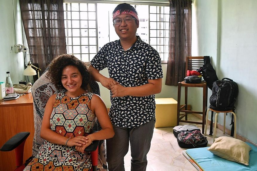 Photographer Ngoh Shian Bang with Couchsurfer Louise Muscolino from Sydney in his bedroom for guests.