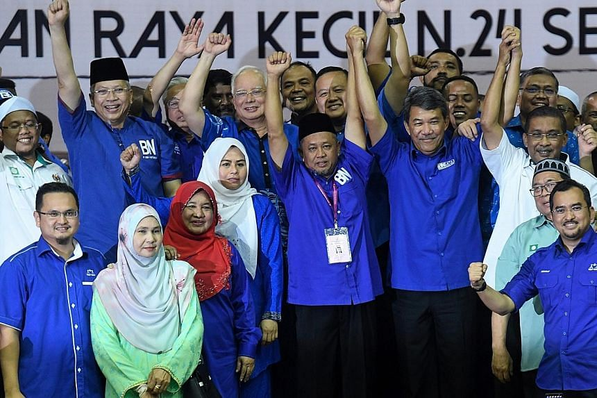 Mr Zakaria Hanafi (centre), Barisan Nasional's candidate for the Semenyih state assembly seat, celebrating his by-election victory on March 2 with fellow opposition party members, including Najib Razak (behind him). The polls result showed a big Mala