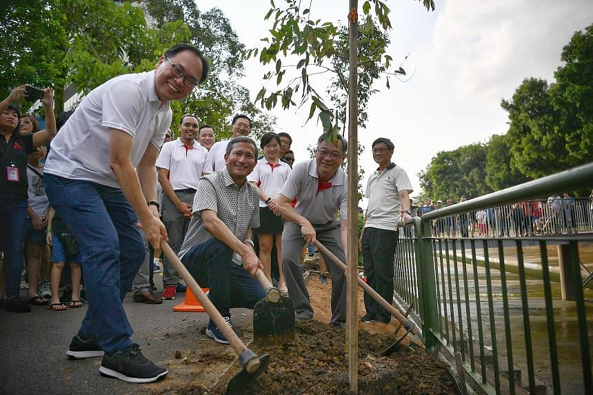 Left: Holland-Bukit Timah GRC MP Liang Eng Hwa (far left) with Foreign Minister Vivian Balakrishnan and Health Minister Gan Kim Yong at the opening of the bridge yesterday. Far left: The Pang Sua Bridge gives residents better access to amenities such