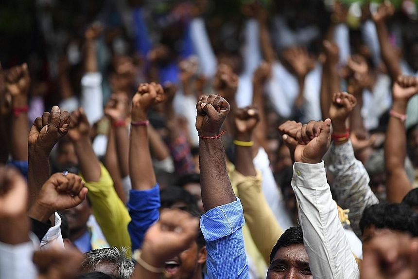 Samajwadi Party (SP) and Bahujan Samaj Party (BSP) supporters at a rally with the Rashtriya Lok Dal. The SP and BSP, representing the poor, have joined forces against the BJP.