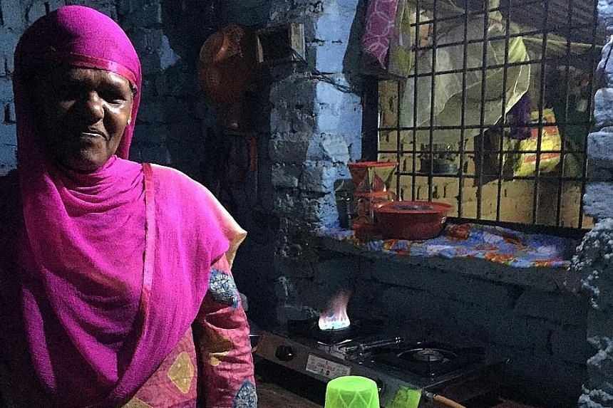 Far left: India's marginalised Dalit community members protesting in New Delhi. Left: Ms Fathima Bano, 46, of Phulpur showing The Sunday Times her brand new gas stove. PHOTOS: AGENCE FRANCE-PRESSE, RAVI VELLOOR India's Prime Minister Narendra Modi wa