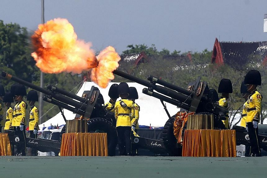 Royal Guards firing a series of cannon salutes during the coronation of Thailand's King Maha Vajiralongkorn yesterday. The Supreme Patriarch pouring water onto King Maha Vajiralongkorn's back and hands during the symbolic purification ceremony at the