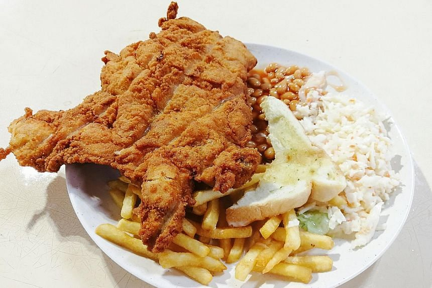 The chicken cutlet dish comes with baked beans, fries, garlic bread and coleslaw.