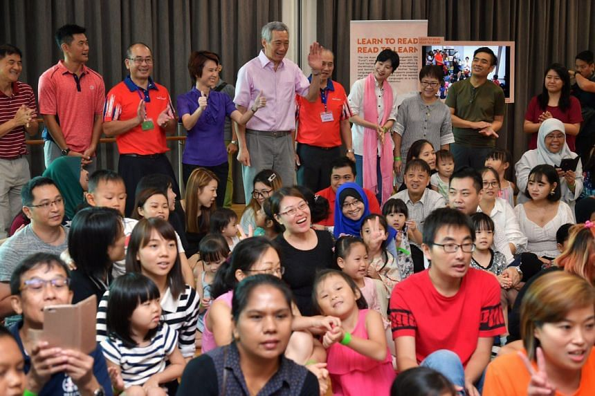 PM Lee Hsien Loong and Ms Low Yen Ling, at a heritage gallery of the new Hillview Community Club.