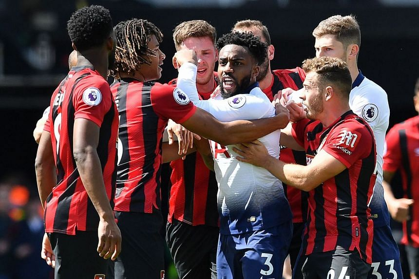 Spurs defender Danny Rose (centre) remonstrates with Bournemouth's Nathan Ake (second left) and Jefferson Lerma (left) during the match.