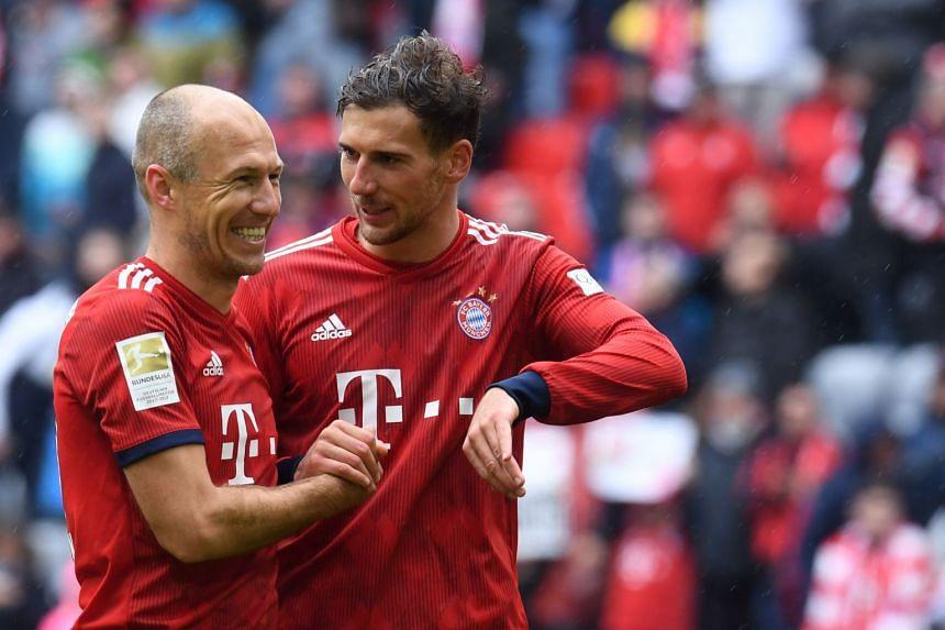 Bayern's Leon Goretzka (right) and Arjen Robben joke after the match.
