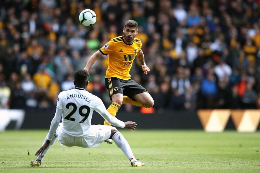 Wolves' Ruben Neves (right) and Fulham's Andre-Frank Zambo Anguissa battle for the ball.