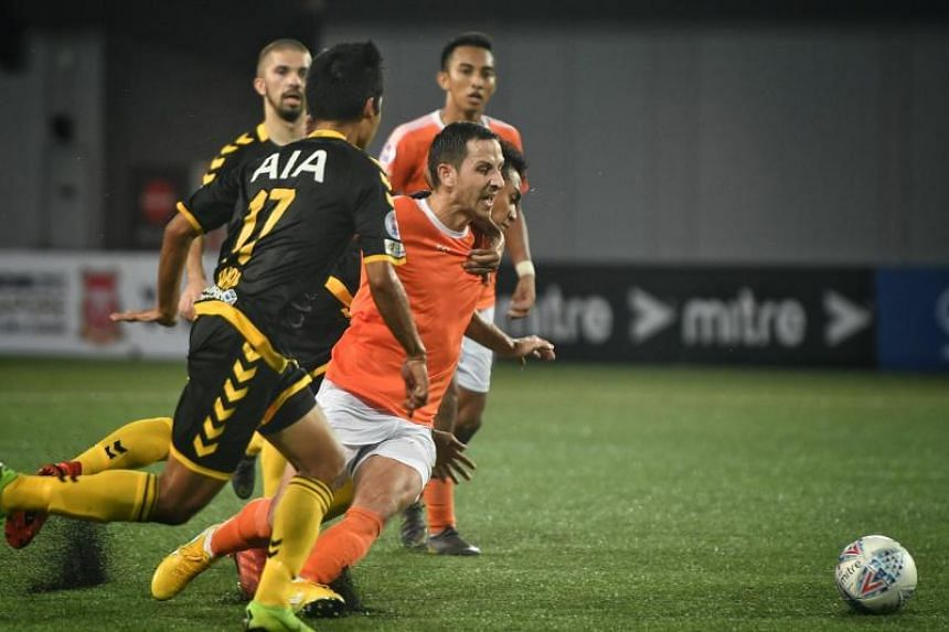 Tampines Rovers and Hougang United players in action during their Singapore Premier League match at Our Tampines Hub on May 5, 2019.