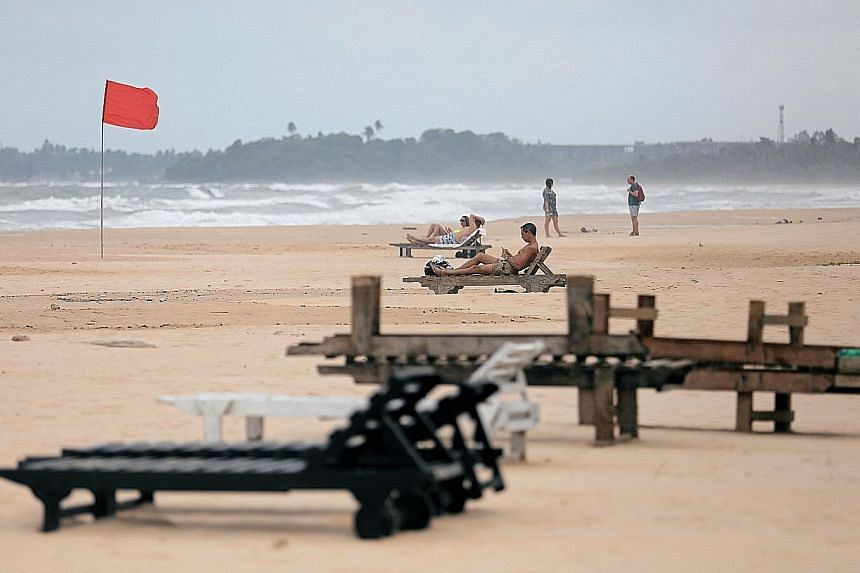 Empty loungers on a beach at a Sri Lankan holiday resort. Tourism, which accounts for 5 per cent of the country's gross domestic product, is suffering as tourists from around the world cancel hotel and flight bookings, fearing more terrorist attacks.