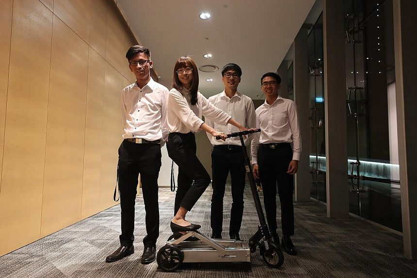 The team of final-year students from the Mechanical Design Engineering programme - comprising (from left) Mr Liew Kar Quan, 23; Ms Wang Xin, 26; Mr Lim Jia Xin, 25; and Mr Chan Xinyin, 24 - with its human-powered scooter ScootMe!.