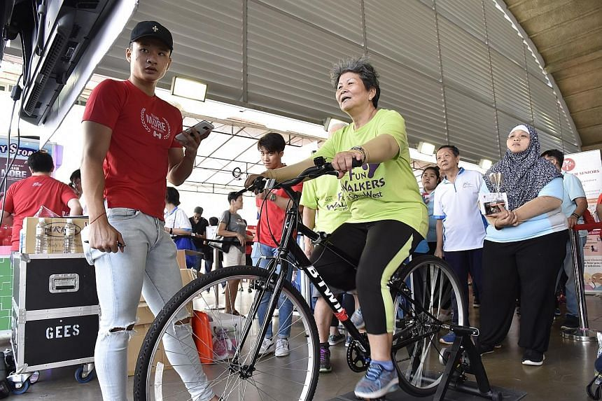 Residents in Jurong taking part in a Gerak Gelak activity in March, organised by the Health Promotion Board and various community groups to get residents to lead healthy lifestyles and exercise.