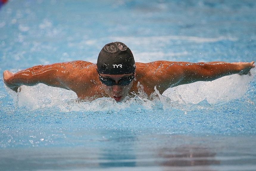 Toh Wei Soong competing in the 50m butterfly which he went on to win at the SPH Foundation National Inclusive Swimming Championships yesterday. ST PHOTOS: ONG WEE JIN