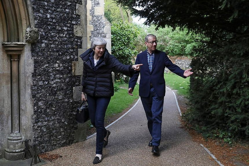 British Prime Minister Theresa May and her husband Philip arriving for a church service yesterday in Sonning, Berkshire. Her Conservative Party and the main opposition Labour took a clobbering in last Thursday's local elections.