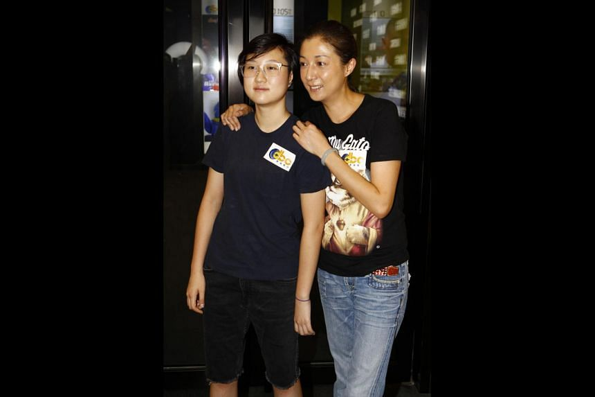 Former beauty queen Elaine Ng, 45, with daughter, Etta.