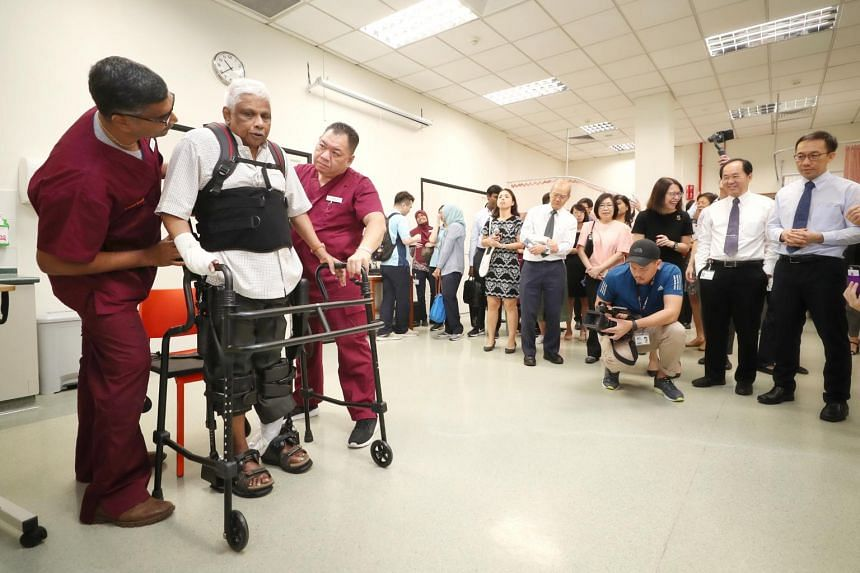 Patient Gandhi Mailvahanam Somukanaya having a therapy session with the help of an exoskeleton suit at the launch of the Temasek Foundation-Improving Mobility via Exoskeletons (iMove) programme at Alexandra Hospital, on May 6, 2019.