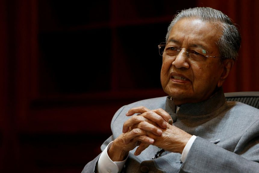 """When asked to evaluate the present Cabinet, Malaysia Prime Minister Mahathir Mohamad gave it a """"five out of 10""""."""