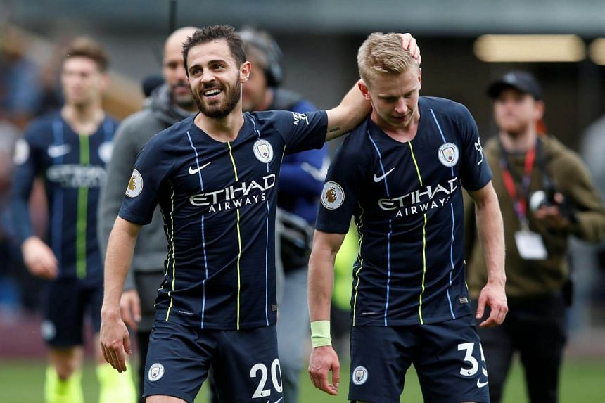 Manchester City's Bernardo Silva and Oleksandr Zinchenko celebrate after their English Premier League football match against Burnley at Turf Moor in Burnley, on April 28, 2019.