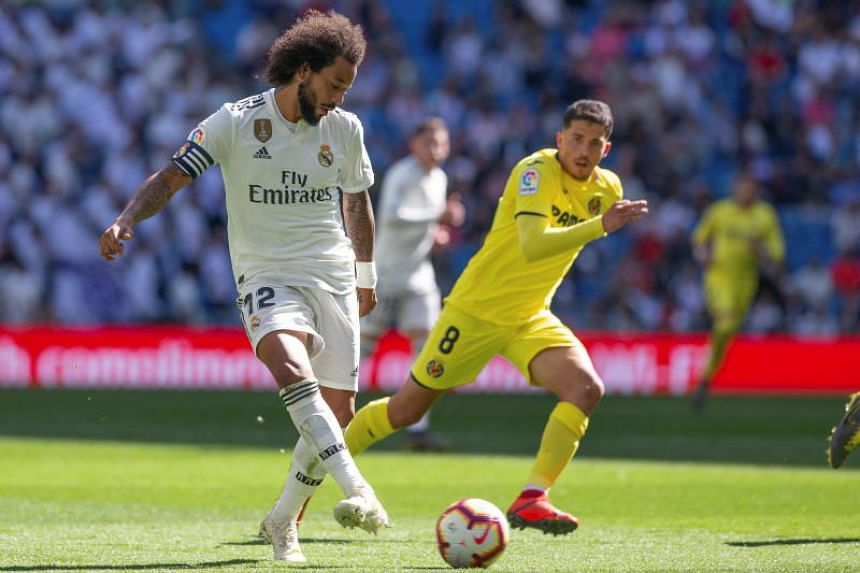 Real Madrid's Marcelo Vieira (left) in action during the match between Real Madrid and Villarreal at the Santiago Bernabeu stadium in Madrid, Spain, on May 5, 2019.