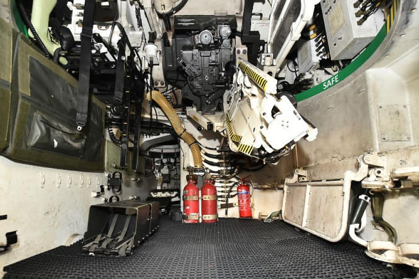 New markings indicating safe areas (green) and areas to exercise caution (yellow and black) seen inside a Singapore Self-Propelled Howitzer.