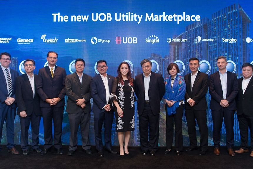 Ms Jacquelyn Tan, UOB head of personal financial services Singapore, (centre) with the 10 utility partners at the launch of its utility marketplace.