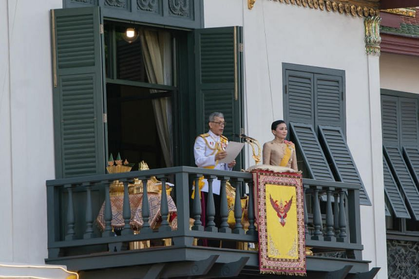Thailand's King Maha Vajiralongkorn and new Queen Suthida were greeted with a band playing the royal anthem and a 21-gun salute.