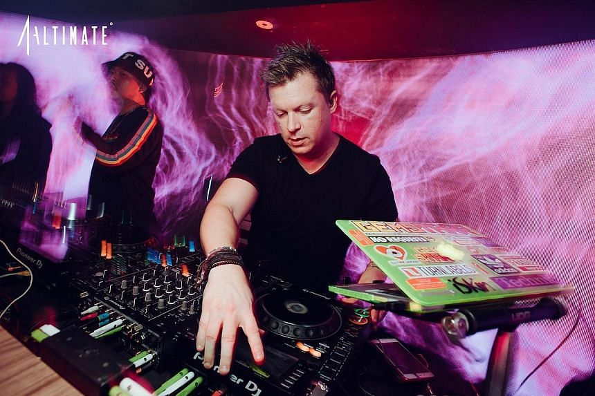"""Adam Sky spinning the decks at Altimate in Raffles Place, which he referred to as """"home base"""" in his social media posts."""