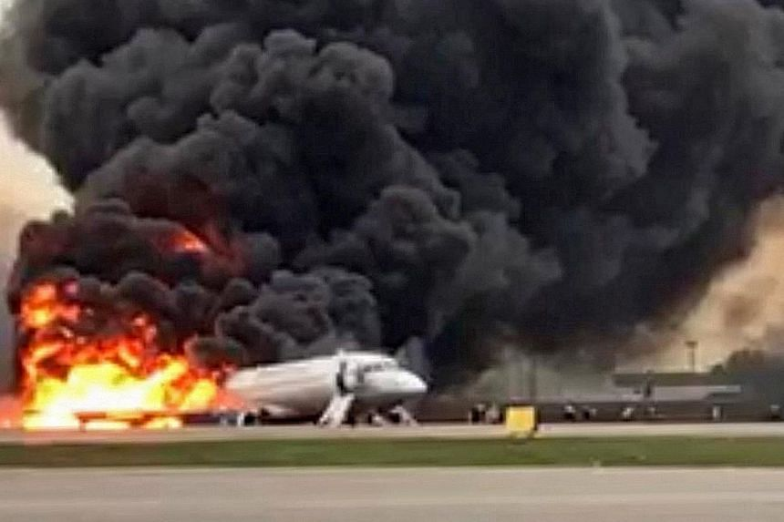 The plane on the tarmac after the fire was put out. At least two children were among the 40 passengers and one crew member who were killed. There were 78 people on the plane when it crashed on Sunday evening.