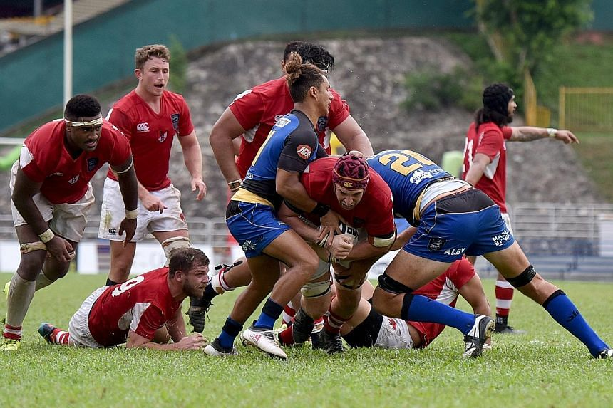 Above: Global Rapid Rugby founder Andrew Forrest's vision is to spread the love of rugby across Asia. Left: The Singapore-based Asia Pacific Dragons (in red) battling Australia's Western Force in their Global Rapid Rugby match last Sunday at Queensto