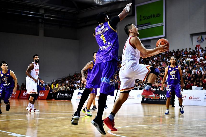 CLS Knights Indonesia fans have warned the Singapore Slingers (in white) of a fiery reception for the Asean Basketball League  Finals Games 3 and 4.
