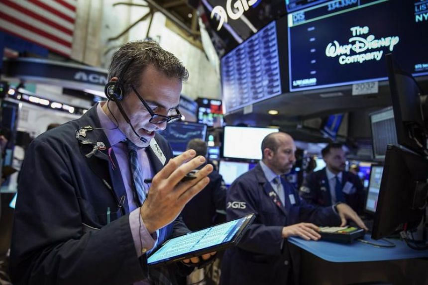 Traders and financial professionals work at the opening bell on the floor of the New York Stock Exchange in New York City, on May 6, 2019.