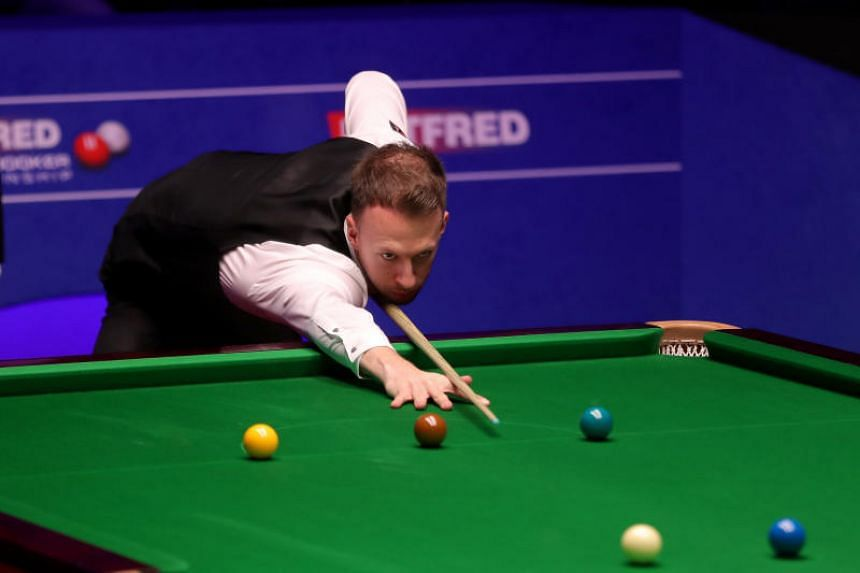 English snooker player Judd Trump competes on the seventeenth day of the 2019 Betfred World Championship at The Crucible, on May 6, 2019.
