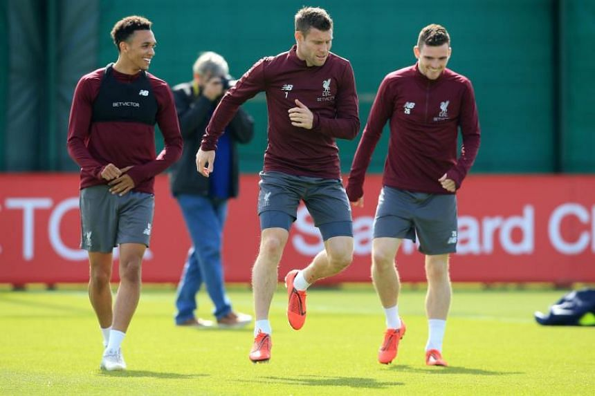 Liverpool's English defender Trent Alexander-Arnold (left), Liverpool's English midfielder James Milner (centre) and Liverpool's Scottish defender Andrew Robertson takes part in a team training session at Melwood in Liverpool, north west England on M
