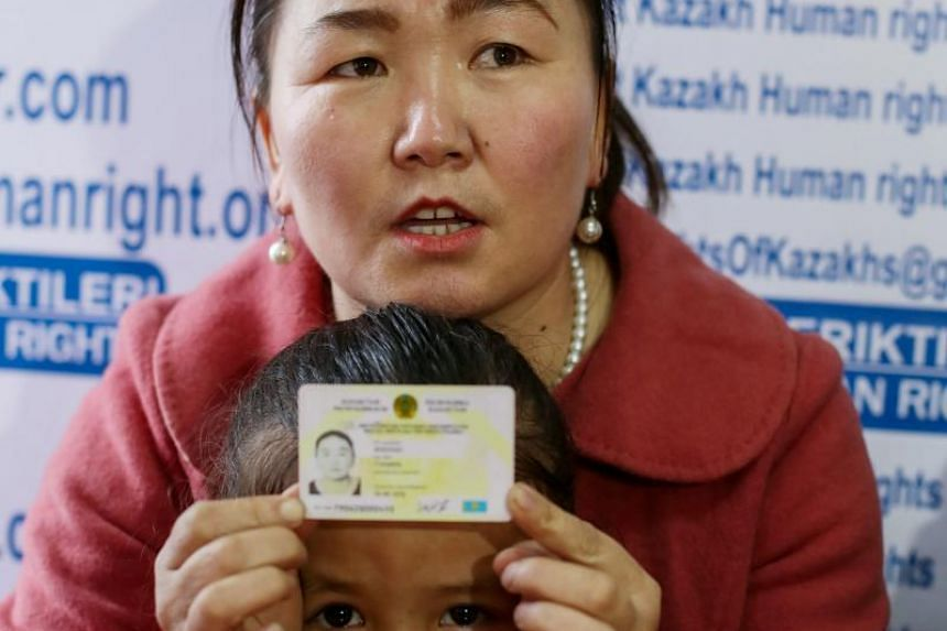 Ms Gulzira Auelkhan, who spent close to two years trapped in China, speaks during an interview at the office of the Ata Jurt rights group in Almaty, Kazakhstan, in January 2019. She is pictured with her five-year-old daughter.