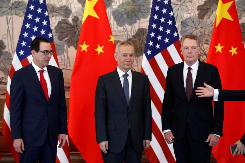 (From left) US Treasury Secretary Steven Mnuchin, Chinese Vice-Premier Liu He and US Trade Representative Robert Lighthizer at a group photo session after concluding their meeting at the Diaoyutai State Guesthouse in Beijing on May 1, 2019.