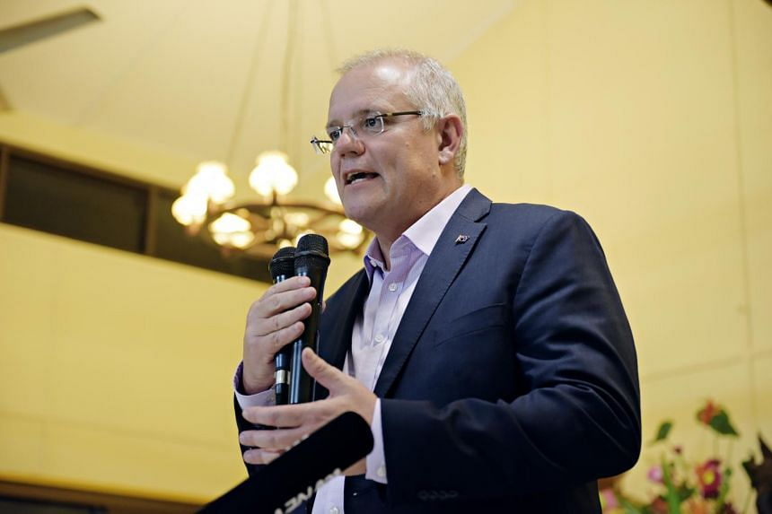 Australian Prime Minister Scott Morrison rubbed his head briefly after a female protestor threw an egg at him.