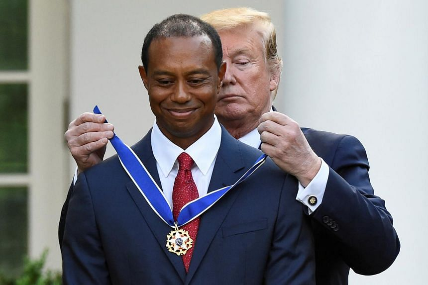 Tiger Woods is awarded the Presidential Medal of Freedom, the highest civilian honour in the US, by President Donald Trump in the Rose Garden at the White House in Washington, on May 6, 2019.