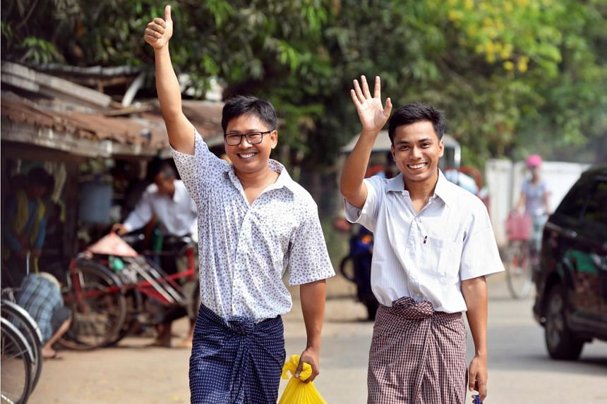 Reuters reporters Wa Lone (left) and Kyaw Soe Oo walk free outside Insein prison after receiving a presidential pardon in Yangon, Myanmar, on May 7, 2019.