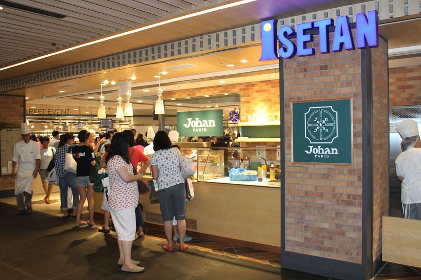 Isetan's outlet at Westgate mall opened in 2013 as one of the anchor tenants, with a department store and a supermarket (right). It is the firm's first such outlet outside the Orchard Road area.