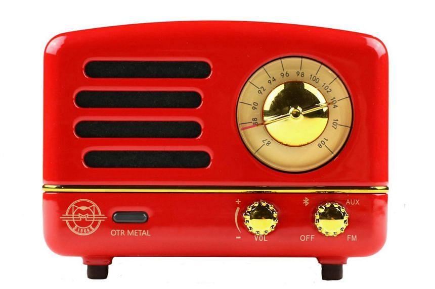 The Muzen OTR Metal is shaped like an old radio set and has a big physical knob surrounded by a circular FM frequency band scale.