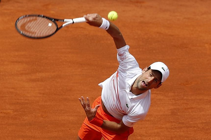 Djokovic in action against US player Taylor Fritz.