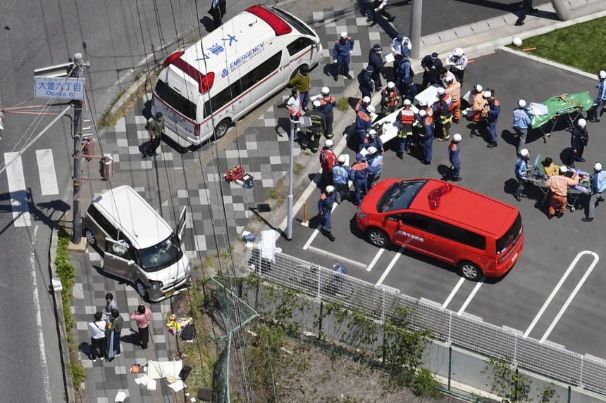 An aerial view of the site showed one car veered up off the road and onto the pavement, ramming into a group of 13 nursery school children and three teachers, in Otsu, western Japan, on May 8, 2019.