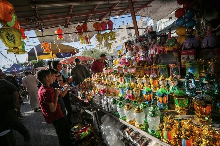 Palestinians shopping in the market during the holy month of Ramadan in Gaza City on May 7, 2019, a day after the ceasefire.