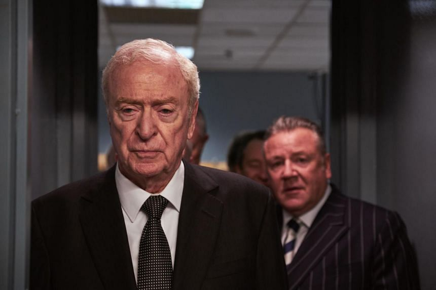 Michael Caine (left) stars as Brian Reader, a seasoned jailbird and burglar who, at age 77, wants to do one more big heist, in the movie King of Thieves.