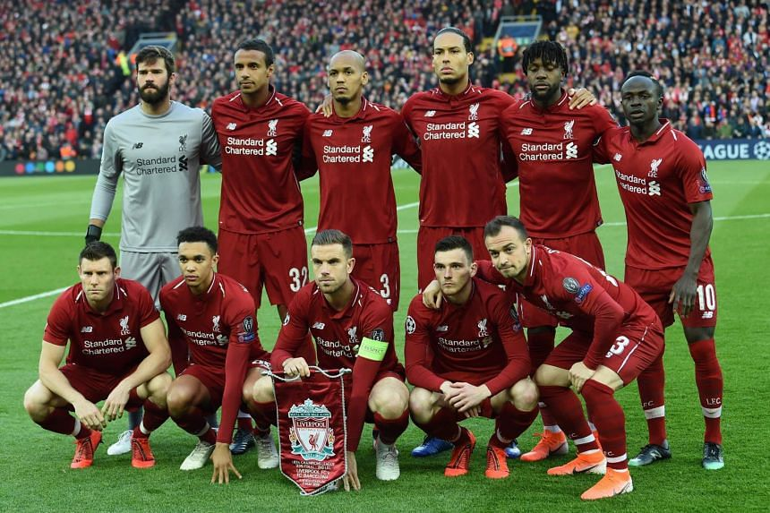 Liverpool team pose before the Uefa Champions league semi-final second leg football match against Barcelona at Anfield in Liverpool, on May 7, 2019.