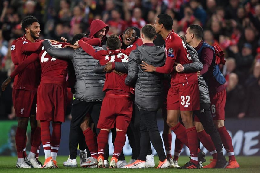 Liverpool players celebrate after winning the Uefa Champions league semi-final second leg football match against Barcelona at Anfield in Liverpool, on May 7, 2019.